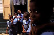 BELIZE / Belize City / Schoolchildren at a primary school during a break...© JOAN COSTA