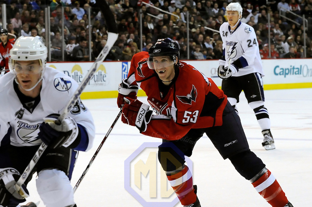 26 December 2007:  Washington Capitals left wing Quintin Laing (53) skates in behind Tampa Bay Lightning defenseman Mike Lundin (39) in the first period at the Verizon Center in Washington, D.C.  The Capitals defeated the Lightning 3-2.