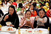 SHANGHAI, CHINA - NOVEMBER 12: (CHINA OUT) <br /> <br /> Dining In Bed For New Guinness Record In Shanghai<br /> <br /> A general view of participants dining in bed at Pudong Shangri-la Hotel on November 12, 2014 in Shanghai, China. 338 participants take their breakfast in 202 beds during the activity of taking breakfast in bed which sets new Guinness record. The previous Guinness record was set by 288 members from Women's Health Initiative on March 12, 2013 in Australia. <br /> ©Exclusivepix