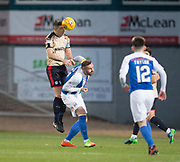 18th November 2017, Dens Park, Dundee, Scotland; Scottish Premier League football, Dundee versus Kilmarnock; Dundee's Darren O'Dea heads clear from Kilmarnock's Kris Boyd