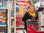 "28 NOVEMBER 2019 - ANKENY, IOWA: WANDA MORTVEDT, from Story county Iowa, wore a reindeer hat when she went shopping at the Target store in Ankeny, Iowa, Thursday. ""Black Friday"" is the unofficial start of the Christmas holiday shopping season and has traditionally thought to be one of the busiest shopping days of the year. Brick and mortar retailers, like Target, are facing increased pressure from online retailers this year. Many retailers have started opening on Thanksgiving Day. Target stores across the country opened at 5PM on Thanksgiving to attract shoppers with early ""Black Friday"" specials.     PHOTO BY JACK KURTZ"