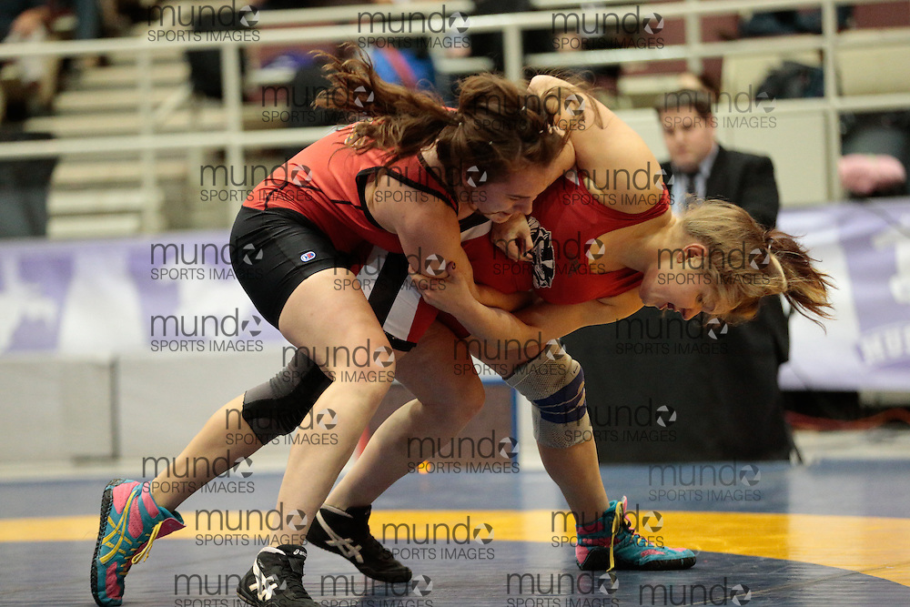London, Ontario ---2013-03-02---   Ocean Burns of The University Of Calgary takes on Marissa Sorrel of Brock in the women's 67 KG bronze medal match at the 2012 CIS Wrestling Championships in London, Ontario, March 02, 2013. .GEOFF ROBINS/Mundo Sport Images