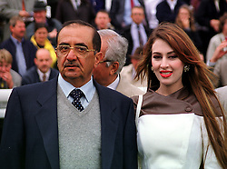 SHEIKH MAKTOUM AL MAKTOUM and his 2nd wife, at a race meeting in Berkshire on 19th September 1999.MWM 42
