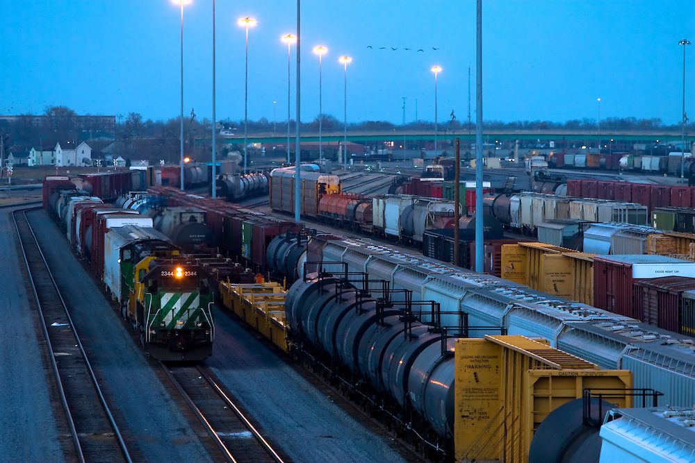 After sunset, yet another freight train pulls into the giant classification yard in Galesburg, IL.