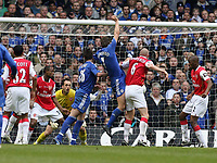 Photo: Rich Eaton.<br /> <br /> Chelsea v Arsenal. Carling Cup Final. 25/02/2007. John Terry of Chelsea #26 jumps for a corner along Andriy Shevchenko, is then injured and leaves the field on a stretcher