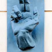 Hand sculpture on wall in Prague representing the papal blessing gesture