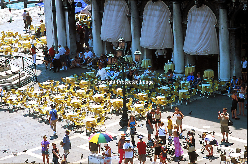 Piazza San Marco in Venice, bar with tourists