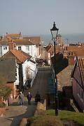 Town Steps, Aldeburgh, Suffolk. Much of the town, has now been lost to the sea. In the 16th century, Aldeburgh was a leading port, and had a flourishing ship-building industry. Sir Francis Drake's ships Greyhound and Pelican (later renamed Golden Hind) were both built in Aldeburgh. The flag ship of the Virginia Company, the Sea Venture is believed to have been built there in 1608. When the River Alde silted up and was unable to accommodate larger ships, the area went into decline. Aldeburgh survived principally as a fishing village until the nineteenth century, when it became popular as a seaside resort. Much of its distinctive and whimsical architecture derives from this period. The river is now home to a flourishing yacht club.
