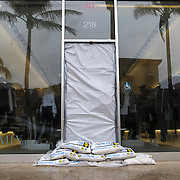 Intermix, a clothing store on Worth Avenue in Palm Beach, has sandbags on the front door against the projected surge of Hurricane Matthew Wednesday October 6, 2016.  Warnings are in place along much of Florida's Atlantic coastline, for Category 3 Hurricane Matthew<br />