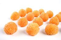 Yellow raspberries on white background