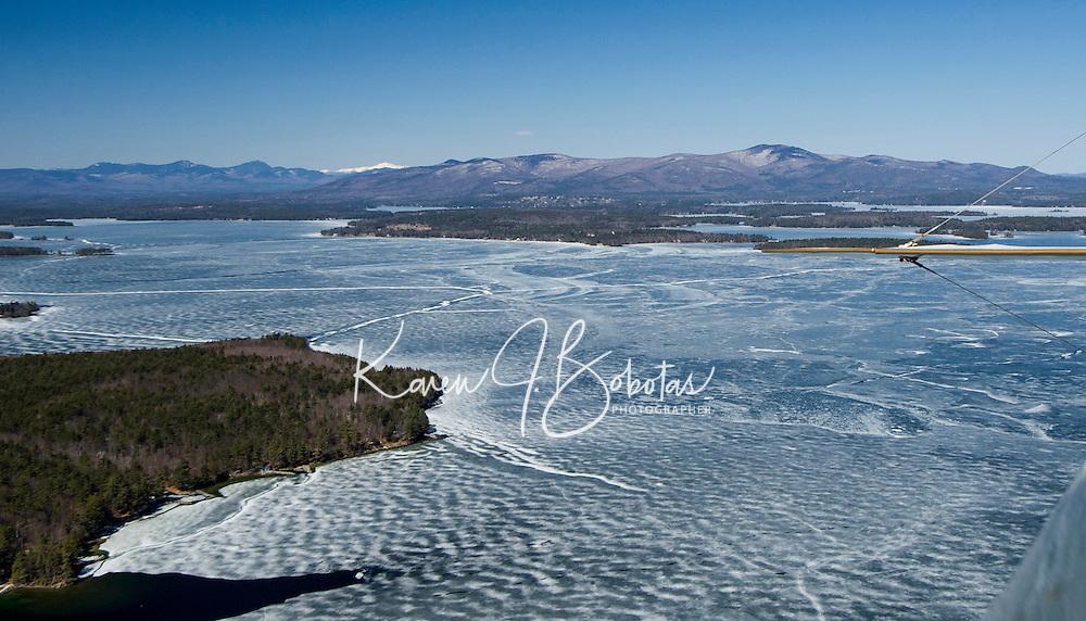 Lakes Biplane takes flight over the Broads on Lake Winnipesaukee Thursday afternoon.  (Karen Bobotas Photographer)
