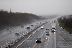 © Licensed to London News Pictures. 26/01/2014. M3, Basingstoke, Hampshire, UK. Cars kicking up spray on the M3 near Basingstoke today (26/01/2014). Wet and windy weather has engulfed much of the UK over the weekend. Photo credit : Rob Arnold/LNP