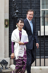 © Licensed to London News Pictures. 21/06/2012. LONDON, UK. Burmese Nobel peace prize winner and former political prisoner Aung San Suu Kyi leaves number 10 Downing Street with British Prime Minister David Cameron in London today (21/0612). Aung San Suu Kyi, the leader of the Burmese opposition, today met with the British Prime Minister David Cameron as part of a trip to the UK. Photo credit: Matt Cetti-Roberts/LNP