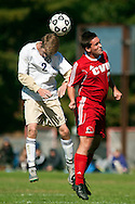 Essex's Aidan Whitney (2) leaps over CVU's Will Yakibuk (21) to head the ball during the boys soccer game between the Champlain Valley Union Redhawks and the Essex Hornets at Essex High School on Saturday mooring October 10, 2015 in Essex. (BRIAN JENKINS/For the FREE PRESS)