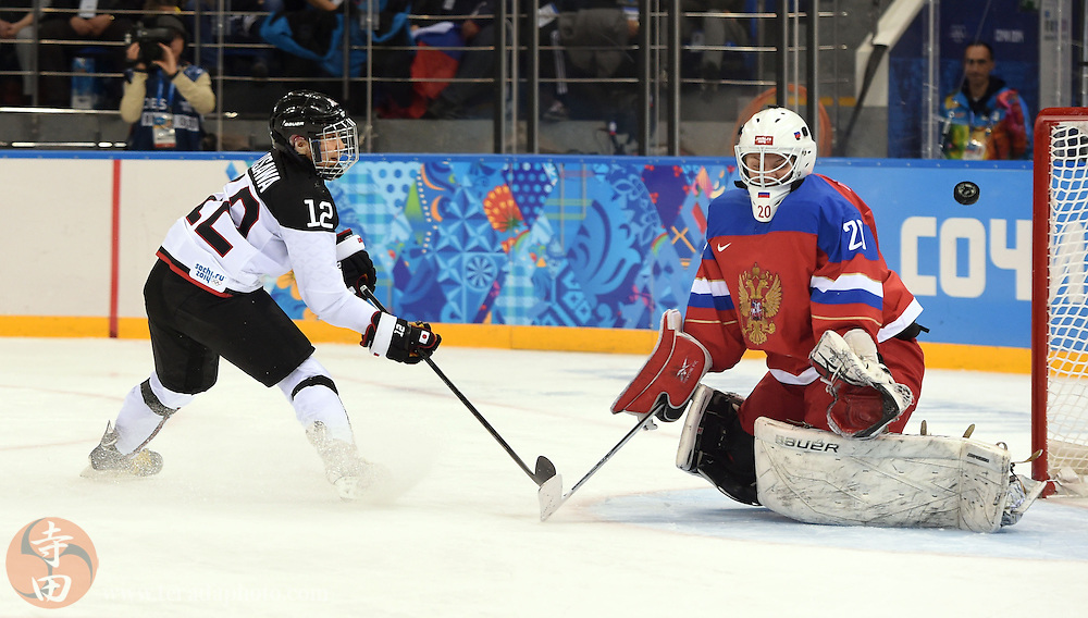 Feb 16, 2014; Sochi, RUSSIA; Russia goalkeeper Yulia Leskina (20) makes a save against Japan forward Chiho Osawa (12) in a women's ice hockey classifications round game during the Sochi 2014 Olympic Winter Games at Shayba Arena.