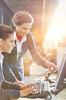 Portrait of young attractive passenger service agents working in airport with lens flare