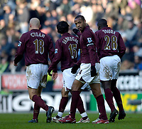 Photo: Jed Wee.<br />Wigan Athletic v Arsenal. The Barclays Premiership.<br />19/11/2005.<br />Arsenal's Thierry Henry celebrates.