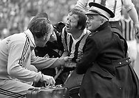 """974-17<br /> Kilkenny goalkeeper Noel Skehan getting attention following a rough tackle described as, """"a belt in the guts"""".<br /> All-Ireland Hurling Final in Croke Park. 1/9/74.<br /> (Part of the Independent Newspapers Ireland/NLI collection.)"""