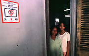 "Phnom Penh, Cambodia. Teenaged girls at The Cambodian Center for the Protection of Children's RIghts, a sanctuary for child prostitutes rescued from Cambodian brothels. Sticker on wall reads ""No Child Sex Tourism"""