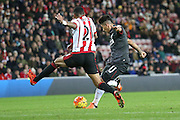 Liverpool midfielder Roberto Firmino  with a shot during the Barclays Premier League match between Sunderland and Liverpool at the Stadium Of Light, Sunderland, England on 30 December 2015. Photo by Simon Davies.