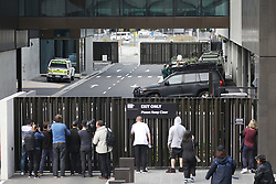 March 17, 2019 - Christchurch, New Zealand - Journalists wait outside the Christchurch District Court for word on the suspected shooter Brenton Tarrant, arrested in connection with the mass shootings at two mosques in Christchurch. At least 49 people have died in the Christchurch mosque shooting, the worst terror attack in New Zealand history. The national security threat level has been increased from low to high for the first time in New Zealand's history after this attack. (Credit Image: © Sanka Vidanagama/NurPhoto via ZUMA Press)