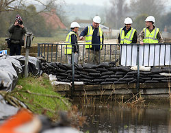 © London News Pictures. 31/01/2014. Burrowbridge, UK. Flood defences being built in Burrowbridge, Somerset on the Somerset levels. The area has been hit severely by recent flooding which is forecast to get worse over the weekend . Photo credit: Jason Bryant/LNP