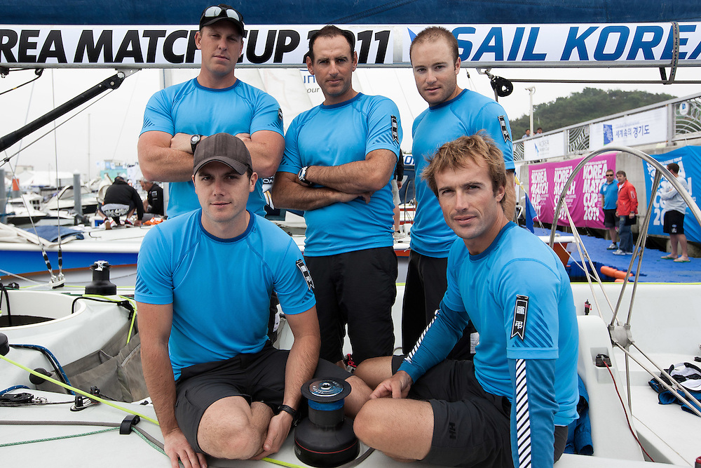 Francesco Bruni and his Bruni Racing Team wearing black tags on the arms to honour team member Massimo Bartoletti's father who passed away on June 8 at the 2011 Korea Match Cup. Gyeonggi Province, Korea. 9 June 2011. Photo: Subzero Images/Korea Match Cup