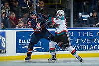 KELOWNA, CANADA - DECEMBER 27: Kyle Topping #24 of the Kelowna Rockets checks Joe Gatenby #37 of the Kamloops Blazers during first period on December 27, 2017 at Prospera Place in Kelowna, British Columbia, Canada.  (Photo by Marissa Baecker/Shoot the Breeze)  *** Local Caption ***