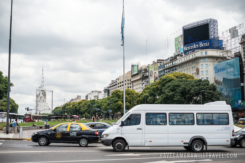 Traffic passes through the Plaza de la República in downtown Buenos Aires, Argentina.