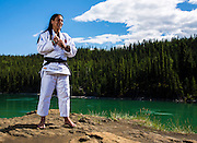 Bianca Ockedahl, a former Judo Canada national team member, poses for a photo at Miles Canyon on June 16, 2016. Ockedahl coaches young Yukon judokas and runs a judo club in the small village of Carmacks, about two hours north of Whitehorse. Photo by Marissa Tiel