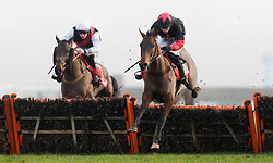 Culture De Sivola, (right) ridden by Lizzie Kelly jumps the last on the way to winning The 32Red Casino Mares' Handicap Hurdle during day two of 32Red Winter Festival at Kempton Park Racecourse.