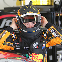 Sprint Cup Series driver Austin Dillon (3) puts on his helmet during the 57th Annual NASCAR Coke Zero 400 practice session at Daytona International Speedway on Friday, July 3, 2015 in Daytona Beach, Florida.  (AP Photo/Alex Menendez)