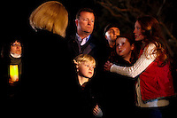 A family from Newtown, Connecticut who did not give their names comfort one another during a candlelight vigil outside Saint Rose of Lima Catholic Church in Newtown, Connecticut in response to a shooting that left at least 26 people dead including 18 children at the Sandy Hook School earlier in the day on December 14, 2012.  A gunman opened fire inside inside Sandy Hook Elementary School early Friday morning where his mother worked.  The suspect 20-year-old Adam Lanza, reportedly killed himself following the shooting rampage inside the school.  This is the worst school shooting in the country's history.  UPI/Matthew Healey