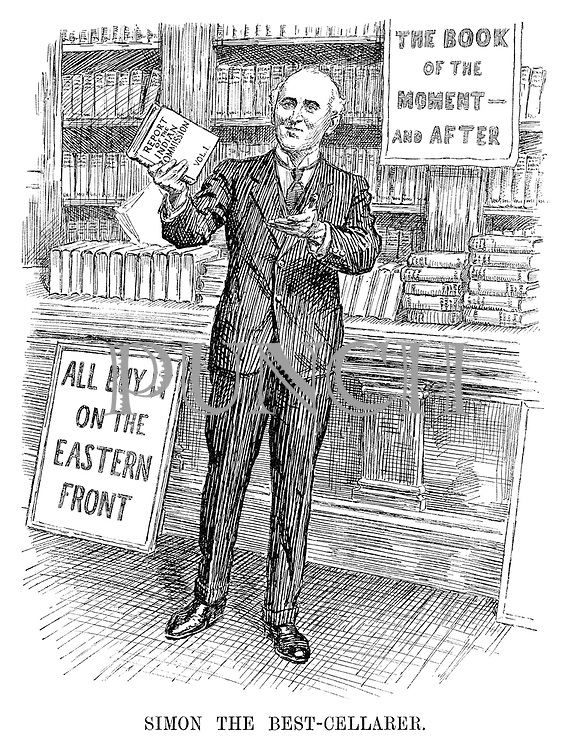 Simon the Best-Cellarer (John Simon holds up his first volume of the 'Report of the Indian Commission' while standing infront of 'The Book of the Moment - And After' and 'All Buy It On The Eastern Front' signs)