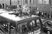 Women sitting on top of bus, 1st Criminal Justice March, Trafalgar Square, London, UK, 1st of May 1994.