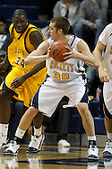 26 January 2010:  Toledo's Jake Barnett (30) and Kent State's Justin Greene (34)    during the NCAA basketball game between Kent State and the Toledo Rockets at Savage Arena in Toledo, OH.