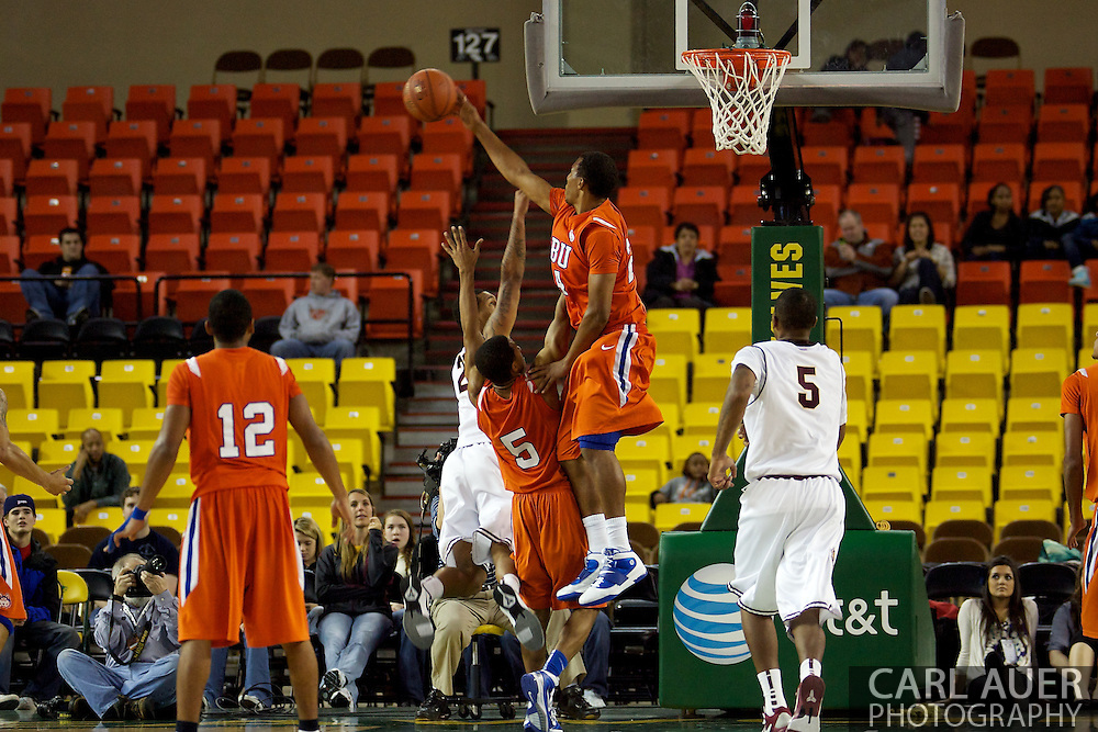 November 25th, 2010:  Anchorage, Alaska - Terry Bembry (24), a forward for Houston Baptist blocks a shot in the Huskies 55-73 loss to the Arizona State Sun Devils at the Great Alaska Shootout.