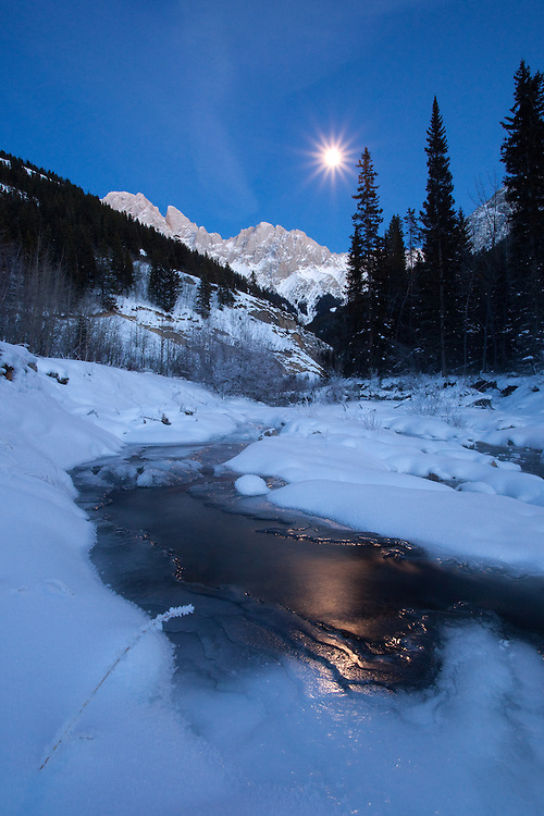 Full moon at King Creek in Kananaskis, Alberta along highway 40 near entrance to Peter Lougheed Provincial Park.