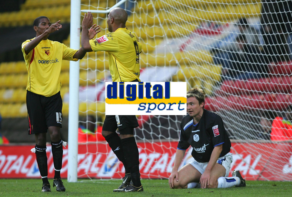 Photo: Frances Leader.<br />Watford v Sheffield Wednesday. Coca Cola Championship.<br />19/11/2005.<br />Watford's Marlon King (C) celebrates scoring the second goal in the first half as Sheffield's Paul Heckingbottom (R) sits in goal.