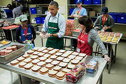 US President Barack Obama visits bags sandwiches with furloughed federal workers, including Dolly Garcia, front right, who works at the U.S. Census Bureau, and Chantelle Burton, left, who works at the Health and Human Services department, and other volunteers at a Martha's Table kitchen on October 14, 2013 in Washington, DC, USA. In a statement to the press, the president called on congress to end the budget stalemate and allow federal employees to return to work. Photo by T.J. Kirkpatrick/Pool/ABACAPRESS.COM  | 418300_017 Washington Etats-Unis United States