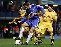 Photo: Paul Thomas.<br /> Chelsea v Levski Sofia. UEFA Champions League, Group A. 05/12/2006. <br /> <br /> Andriy Shevchenko (C) tries to keep off Zhivko Milanov (R) and Elin Topuzakov.