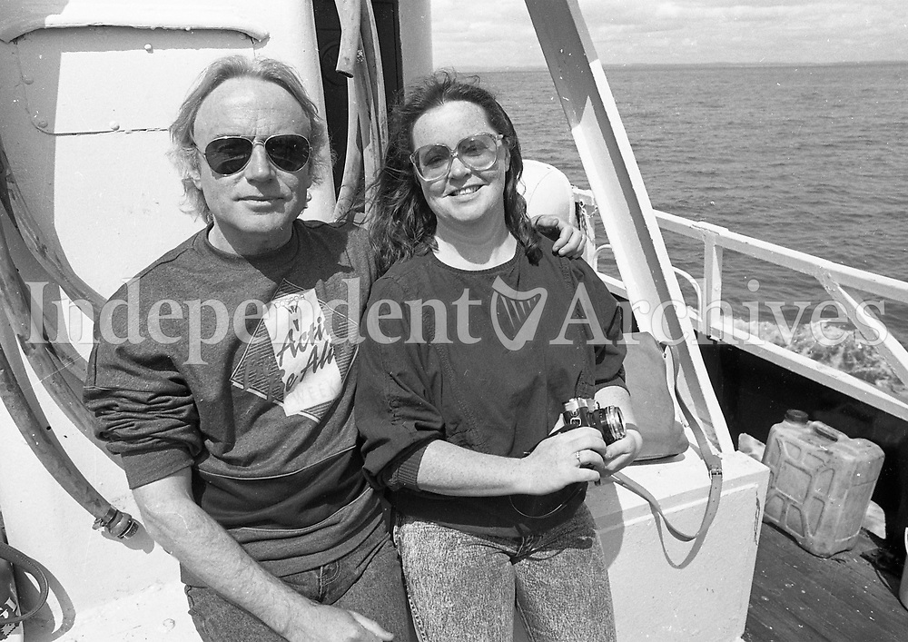 A couple enjoying a day out at sea, names, date and location unknown.<br />