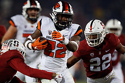 PALO ALTO, CA - NOVEMBER 10: Running back Jermar Jefferson #22 of the Oregon State Beavers rushes up field past cornerback Obi Eboh #22 of the Stanford Cardinal during the second quarter at Stanford Stadium on November 10, 2018 in Palo Alto, California. (Photo by Jason O. Watson/Getty Images) *** Local Caption *** Jermar Jefferson; Obi Eboh