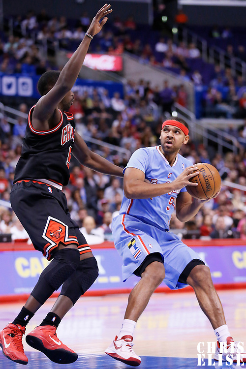 24 November 2013: Los Angeles Clippers small forward Jared Dudley (9) drives past Chicago Bulls small forward Luol Deng (9) during the Los Angeles Clippers 121-82 victory over the Chicago Bulls at the Staples Center, Los Angeles, California, USA.