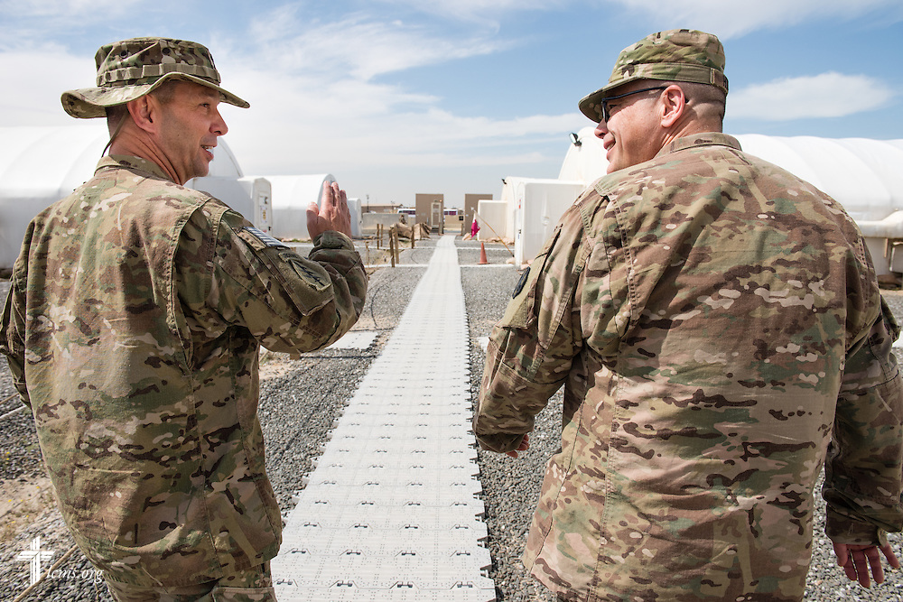 Army Lt. Col Steven Hokana, chaplain, walks with a fellow chaplain at Camp Arifjan on Tuesday, March 24, 2015, in Kuwait. LCMS Communications/Erik M. Lunsford