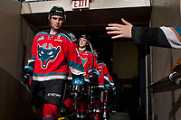 KELOWNA, CANADA - OCTOBER 13: Dillon Dube #19 of the Kelowna Rockets leads the team through the tunnel to the ice against the Calgary Hitmen on October 13, 2017 at Prospera Place in Kelowna, British Columbia, Canada.  (Photo by Marissa Baecker/Shoot the Breeze)  *** Local Caption ***