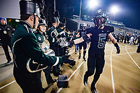 The Granite Bay Grizzlies greet the marching band before the game as the Granite Bay Grizzlies host the the Del Oro Golden Eagles in the Sac-Joaquin Section Division II championship game at Hornet Stadium at Sacramento State, Saturday Dec 2, 2017. <br /> photo by Brian Baer