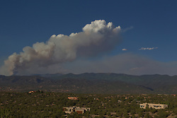 fire above the Santa Fe Mountains in Santa Fe, NM