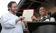 D.C. Mayor Adrian Fenty presents restaurateur Michael Landrum with an award for opening Ray's the Steaks East River.