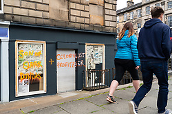 Edinburgh, Scotland, UK. 9 June 2020. Following the Black Lives Matter protests, anti racism campaigners have targeted statues of historical figures who were allegedly involved in the slave trade. The statue of Henry Dundas, the first Viscount Melville in St Andrew Square has been targeted by politicians who want it removed. Also targeted was this shopfront in Dundas Street that was sprayed with graffiti. Iain Masterton/Alamy Live News